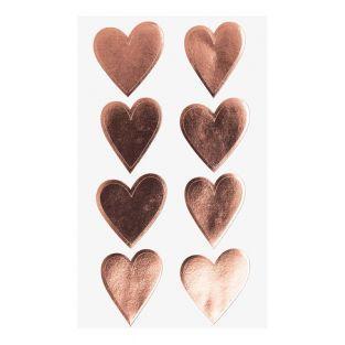 4 feuilles d'autocollants coeurs...