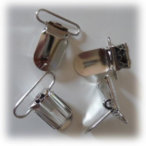 Attaches pour bretelles ou tétines