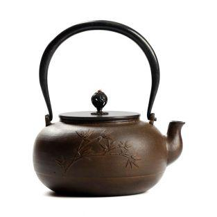Brown round cast iron teapot - leaf...