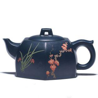 Black earthenware teapot with flowers...