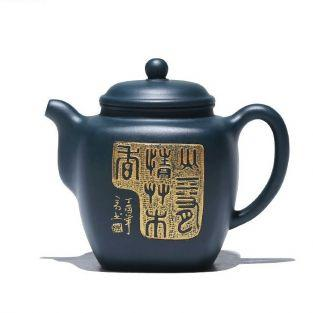 Black earthenware teapot with golden...