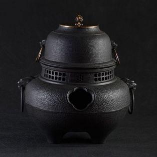 Cauldron teapot with black cast iron...